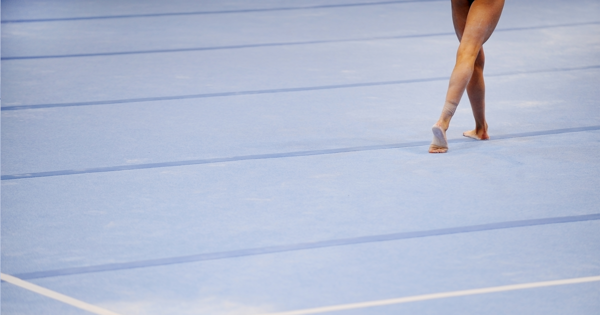 Feet of a girl on a gymnastics mat
