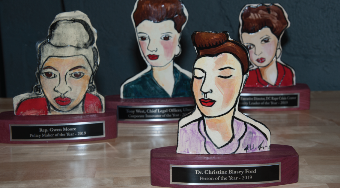 Four painted statuettes that are designed to look like different women