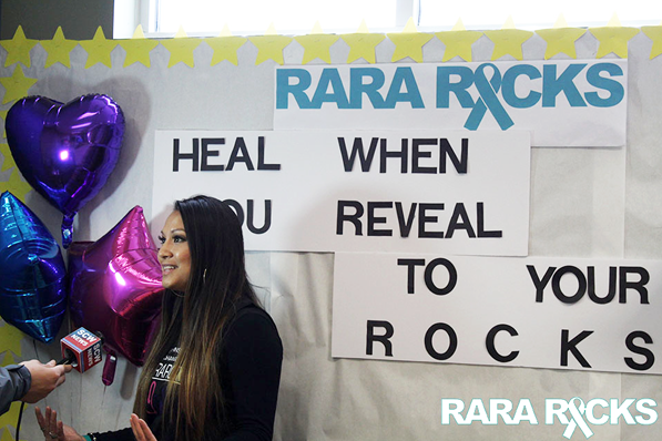 The coordinator of the Rara Rocks event speaks to someone off-camera.