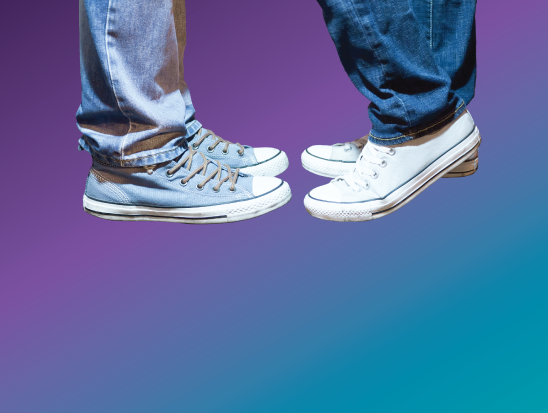 Image of two pairs of feet in shoes, toe-to-toe
