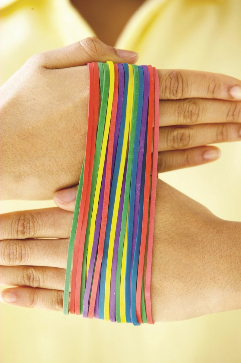 woman with rainbow colored rubber bands on hand