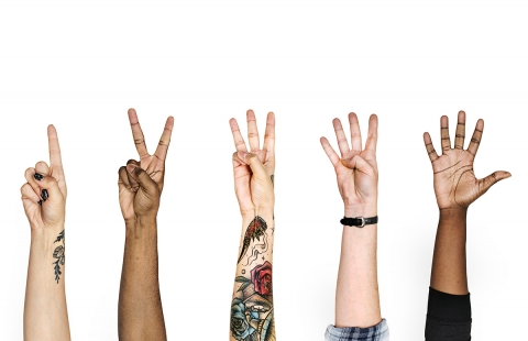 five different hands, each holding up a number of fingers from one to five