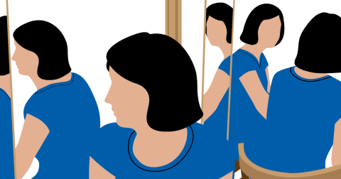 Woman looking in many different mirrors