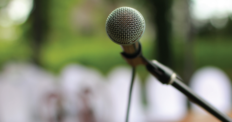 Up-close shot of a microphone pointed toward the reader