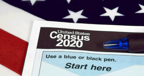 Paper version of the 2020 US Census against an American flag